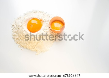 Egg and flour on a white background