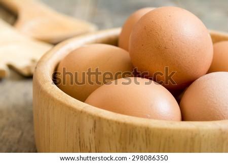 Egg, Chicken Egg in wood bowl - stock photo