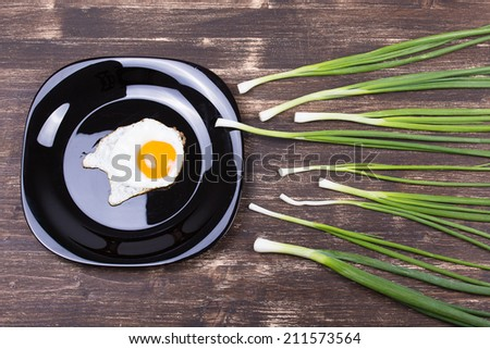 Egg , chives and black plate look like sperm competition, Spermatozoons floating to ovule - stock photo