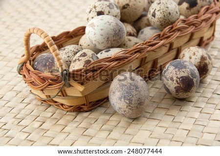 Egg collection isolated on white background. Brown eggs in a Wicker basket.