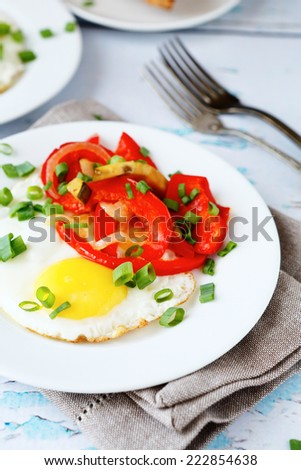 Egg fried with vegetables, food closeup