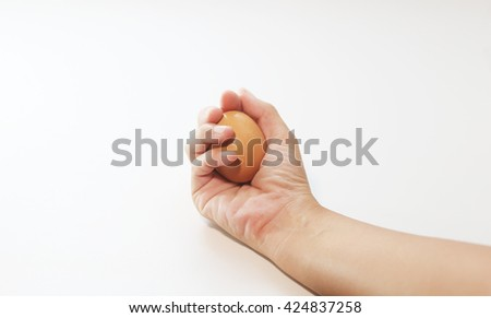 egg in hand on white background