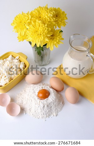 egg, milk, flour on a white background