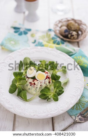 Egg nest appetizer with greens - stock photo