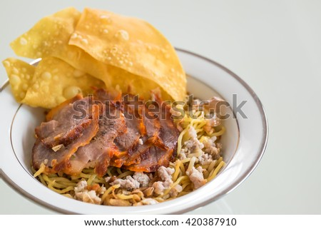 Egg noodle served dry with red roast pork