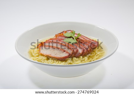Egg noodle soup with pork isolated on white background