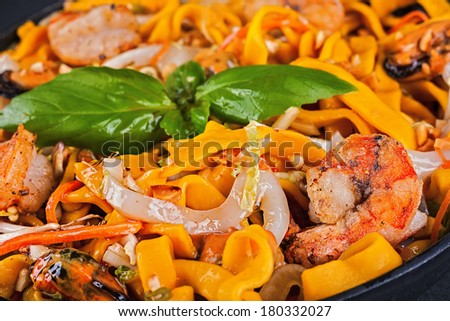 Egg noodles and seafood with sauce teriyaki