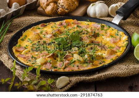 Egg omeletta with ham and herbs, bio eggs and little bit of lime juice