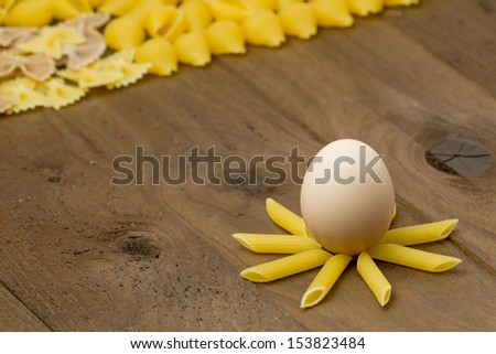 Egg on the crown of Pasta. Short depth-of-field. - stock photo