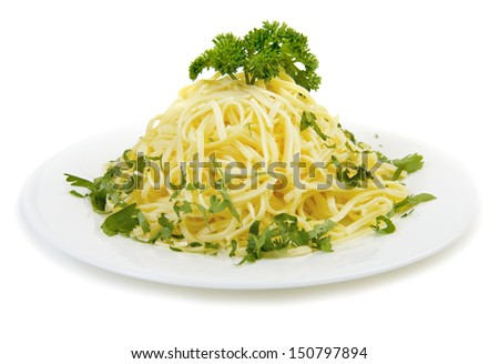 Egg pasta with herbs at white plate. Isolated - stock photo