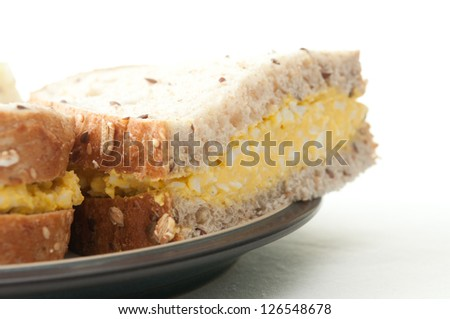 egg salad sandwich on whole wheat - stock photo