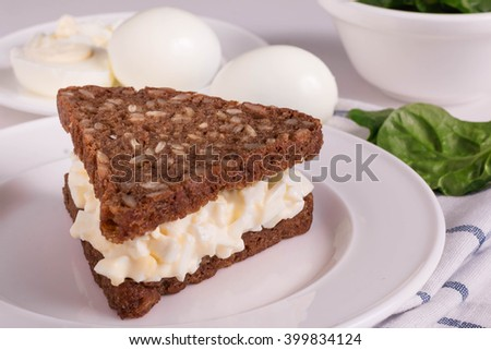 Egg Salad Sandwiches with Whole Grain Bread. Healthy Sandwich for Breakfast. - stock photo