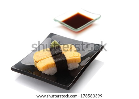 egg sushi isolated in white background