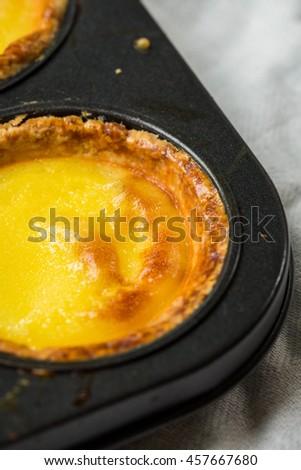 Egg Tart. Egg Custard Tart. Asian Famous Dessert, Crispy and Melt. Homemade Fresh Baked. Selective. - stock photo
