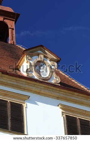 Eggenberg castle (Graz, Austria): architectural details of the roof with blue sky in the background. - stock photo