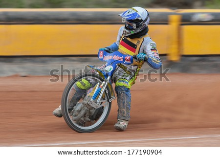 EGGENDORF,  AUSTRIA - APRIL 28 Ronny Weis (#10 Germany) places 2nd in the Austrian speedway championship on April 28, 2013 in Eggendorf, Austria. - stock photo