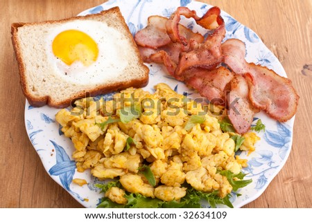 eggie bread, scrambled eggs and fried bacon