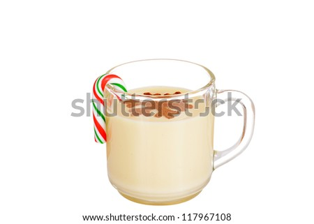 eggnog with a candy cane - stock photo