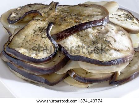 Eggplant baked with potatoes - stock photo