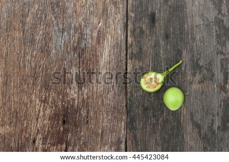 eggplant  fresh organic green vegetable on wooden background. Solanum melongena  Solanum virginianum  - stock photo