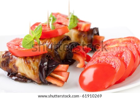 Eggplant rolls stuffed with pepper - stock photo
