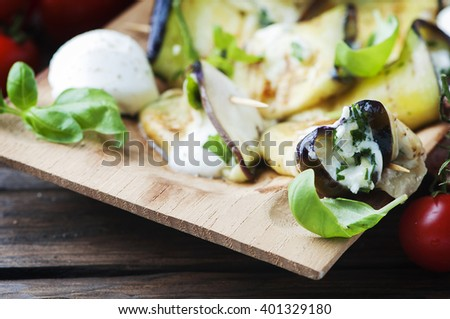 Eggplant rolls with cottage cheese, selective focus - stock photo