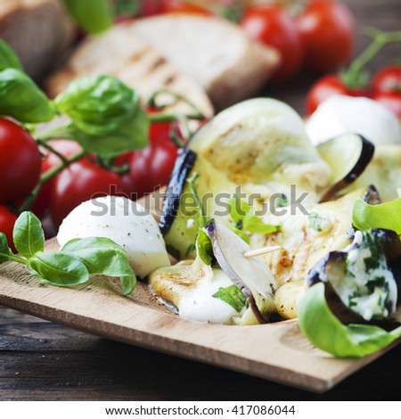 Eggplant rolls with mozzarella cheese, selective focus and square image - stock photo