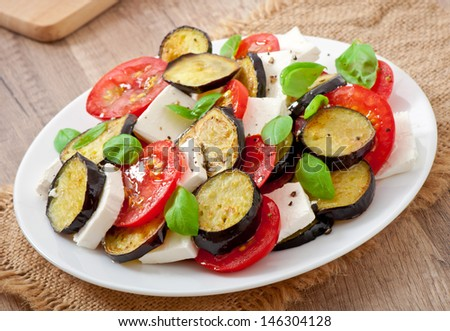 eggplant salad with tomato and feta cheese - stock photo