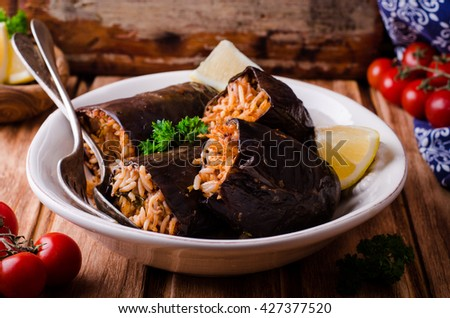 eggplant stuffed with meat and rice in bowl on wooden background. Selective focus. Arabian cuisine - stock photo