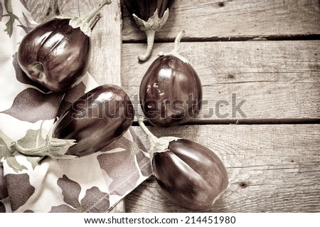 Eggplants on a wooden background