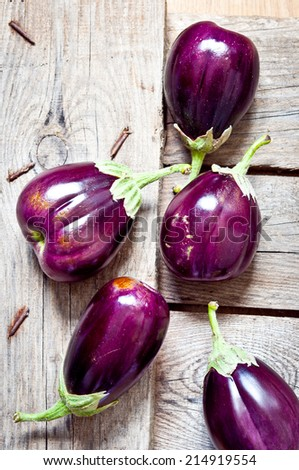 Eggplants on a wooden background - stock photo