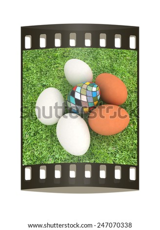 Eggs and easter eggs and grass. The film strip - stock photo