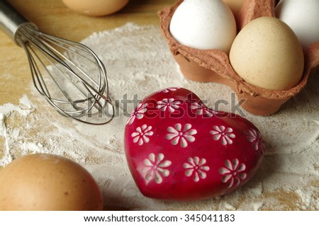 eggs and eggbeater and heart