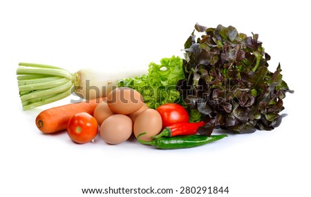Eggs and Fresh vegetables isolated on background. - stock photo