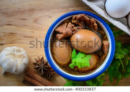 Eggs and pork in brown sauce,Thai Cuisine , Boiled eggs with chicken drumstick in sweet gravy.Eggs and pork in brown sauce, chinese braised soy sauce eggs
