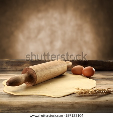 eggs and roller on desk  - stock photo