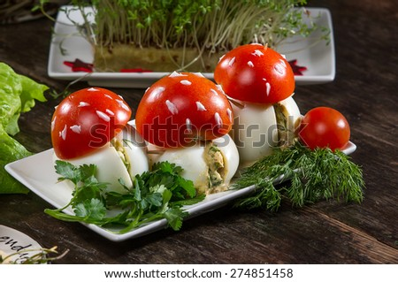Eggs and tomatoes snack look like  mushrooms - stock photo