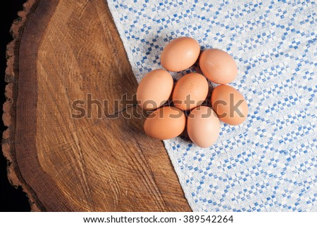 eggs and towel with a blue pattern lie on a wooden table