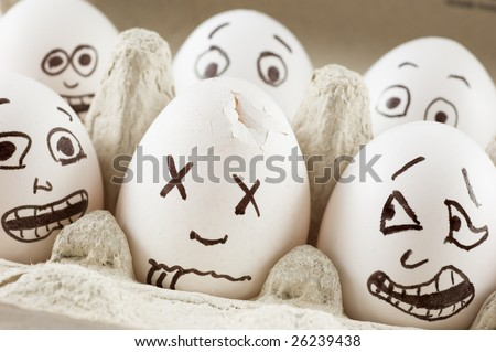 Eggs are scared as they see dead neighbor - stock photo