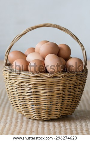 Eggs arranged in a beautiful wicker basket. - stock photo