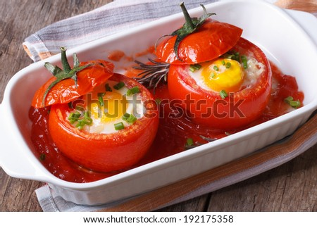 Eggs baked in tomato top view. close up horizontal  - stock photo