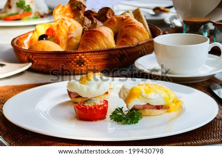 Eggs Benedict served for delicious breakfast - stock photo