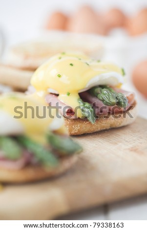 Eggs Benedict with ham & asparagus - shallow dof - stock photo