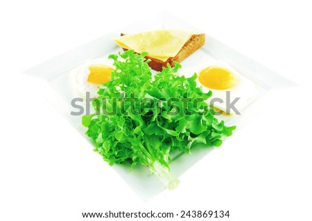 eggs,cheese, salad, and bread on white plate - stock photo