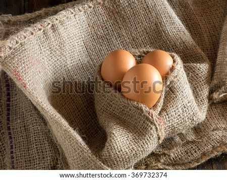 Eggs covered by burlap sack