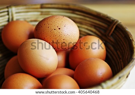 Eggs. Eggs in basket. Fresh organic raw eggs in wooden basket. - stock photo