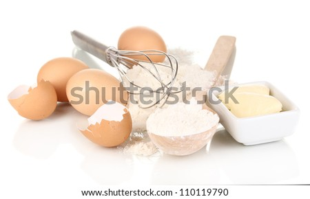 Eggs, flour and butter isolated on white