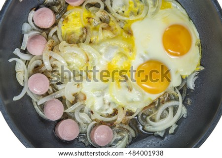 eggs fried with onion and sausage