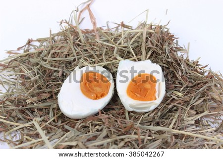 Eggs half a bubble on a pile of straw.