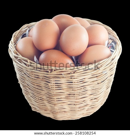 Eggs in a basket on black background